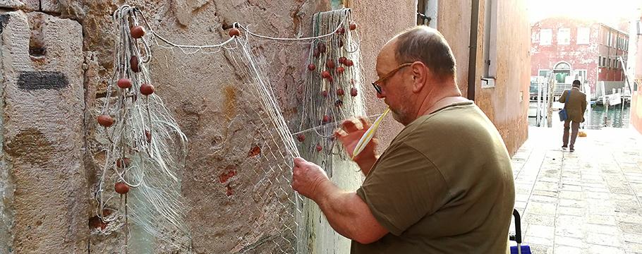 Repairing a fishing net in Venice